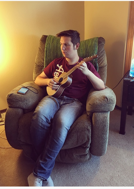 Tanner playing Noah's Ukulele. Noah was so happy he was able to come over